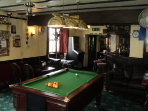A pool table at Ostler Inn