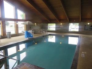 The swimming pool at or near AmericInn by Wyndham Worthington