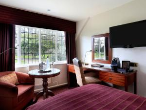 A television and/or entertainment center at Macdonald Craxton Wood Hotel & Spa