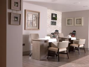 A restaurant or other place to eat at Macdonald Craxton Wood Hotel & Spa
