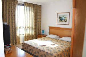 A bed or beds in a room at Studios By The Sea