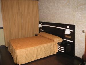 Кровать или кровати в номере Hotel Machaco