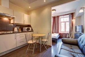 Кухня или мини-кухня в СТН Апартаменты на Невском 60