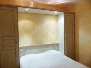 Un ou plusieurs lits dans un hébergement de l'établissement Appart'hôtel Victoria Garden La Ciotat