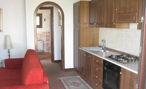 A kitchen or kitchenette at Holiday home Casetta