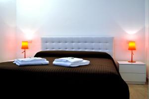 Letto o letti in una camera di BB Hotels Aparthotel Bocconi