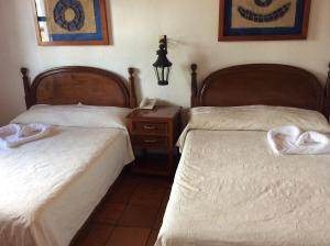 A bed or beds in a room at Meson de Santiago
