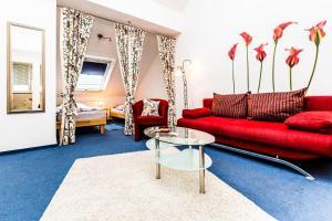 Ein Sitzbereich in der Unterkunft Relax Apartment Köln Merheim
