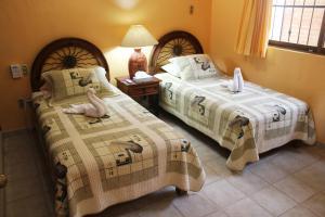 Cama o camas de una habitación en Departamento Marcela #1