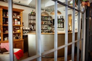 De lounge of bar bij Jungmann Hotel