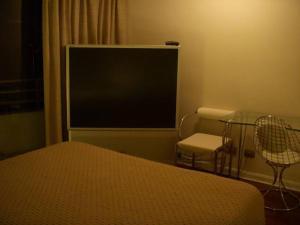 Cama ou camas em um quarto em Departamentos Amoblados Costa 151