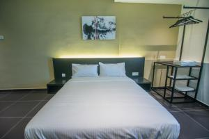 A bed or beds in a room at Ink Hotel