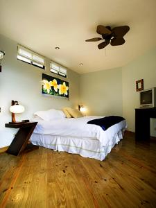 A bed or beds in a room at Out of Bounds Boutique Hotel