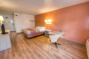 A bed or beds in a room at Motel 6-Branford, CT - New Haven