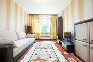 A seating area at Busines Brusnika Apartment Tyoply Stan