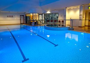 The swimming pool at or near DoubleTree by Hilton Coventry