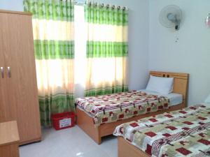 ドン ハイ ホテルにあるベッド