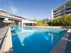The swimming pool at or near Oaks Brisbane Mews Suites