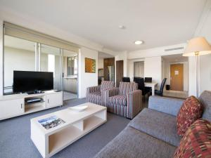 A seating area at Oaks Brisbane Mews Suites