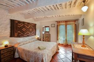 Cama o camas de una habitación en Casa Maite - Bubión