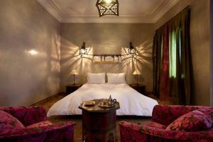 Un ou plusieurs lits dans un hébergement de l'établissement Riad Les Bougainvilliers