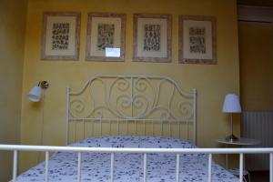 Letto o letti in una camera di B&B Il Torrazzo