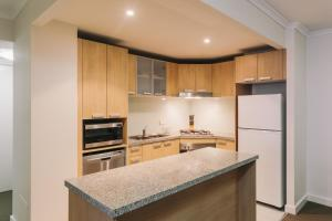 A kitchen or kitchenette at Newcastle Central Plaza Apartment Hotel