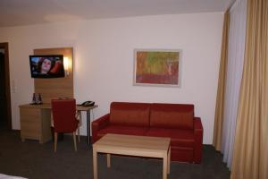 Ein Sitzbereich in der Unterkunft Haus Hennche