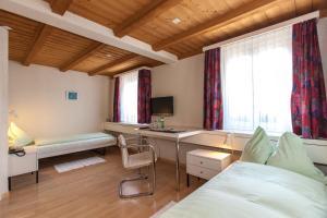 Ein Bett oder Betten in einem Zimmer der Unterkunft Seminarhotel Linde Stettlen