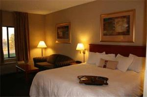 A bed or beds in a room at Hampton Inn Mitchell