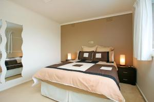A bed or beds in a room at Frankston Unicare