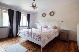 A bed or beds in a room at Vakantiewoning Tivoli