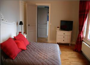 Кровать или кровати в номере La Demeure de Laclais
