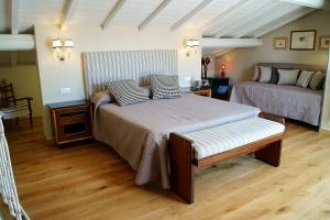 A bed or beds in a room at Greenhouse