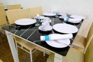 A restaurant or other place to eat at Syaz Meridien Hotel
