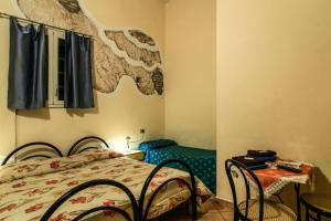A bed or beds in a room at Albergo Aurora