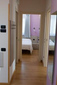 A bed or beds in a room at Residence CaFelicita