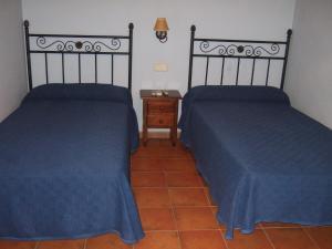 A bed or beds in a room at La Plata de Oropesa