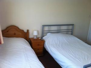 A bed or beds in a room at Hillingdon Lodge