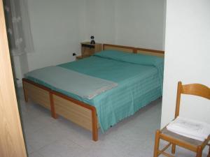 Un ou plusieurs lits dans un hébergement de l'établissement Apartment Ponte Alba