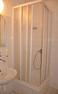 Koupelna v ubytování Hotel Komárov