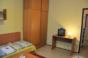 Postel nebo postele na pokoji v ubytování Hotel Komárov