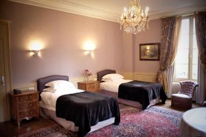 Un ou plusieurs lits dans un hébergement de l'établissement Château D'Apigné Rennes