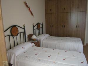 Cama o camas de una habitación en Hotel Rural El Molinero de Santa Colomba de Somoza