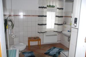 Ein Badezimmer in der Unterkunft Apartments Gästehaus Im Lindenhof