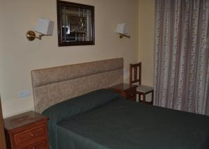A bed or beds in a room at Hotel Roma