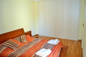 A bed or beds in a room at Apartamento Golf Resort