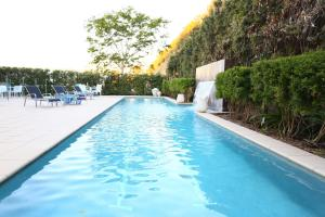 The swimming pool at or near Springfield Lakes Boutique Hotel