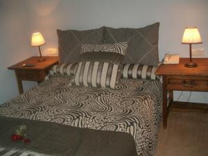 A bed or beds in a room at Hospederia El Batan