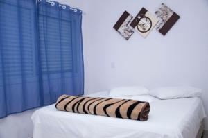 A bed or beds in a room at Sanches Hotel